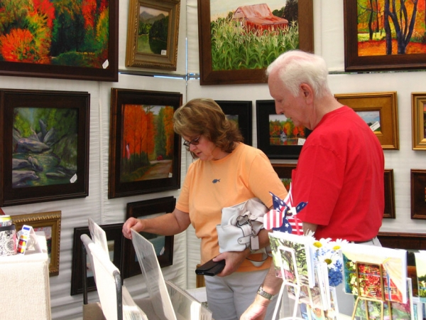 customers browsing through work by Sue Gouse